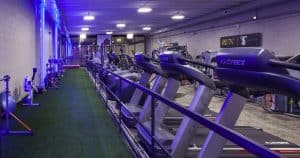 Training Station track and treadmills in blue lighting