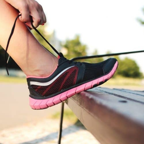 pink running shoe on bench