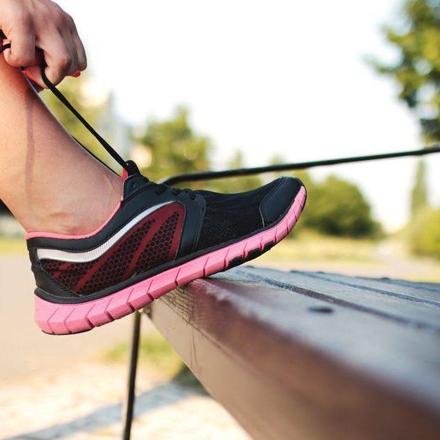 pink running shoe on bench